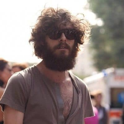 Guy with shades and curls