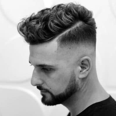 Guy with undercut and curls