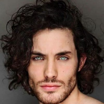 teased curly hairstyles for men