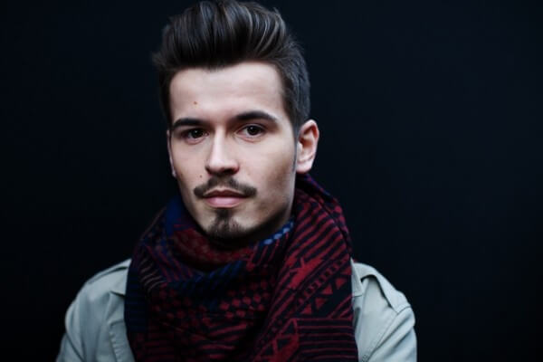 Man with goatee and fluffy scarf