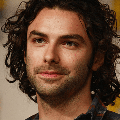 Unshaved guy with thick curls