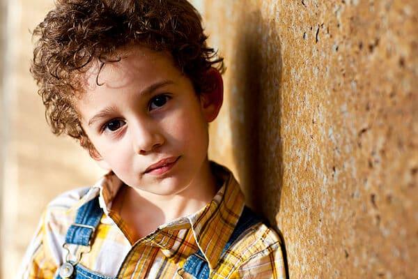 little boy sporting a curly haircut