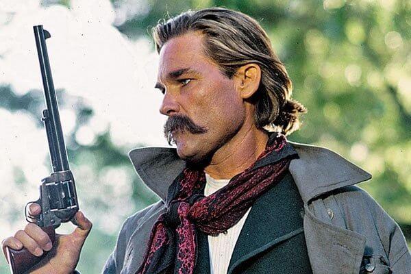 Kurt Russel holding a gun
