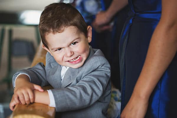 little boy making faces at the photographer