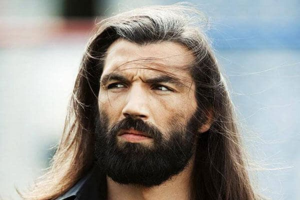 tough looking man with long hair