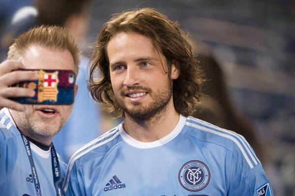 soccer player with long hair