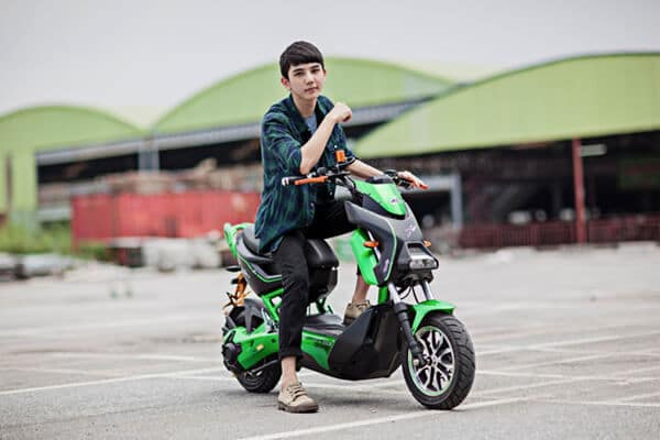 teenager riding his scooter
