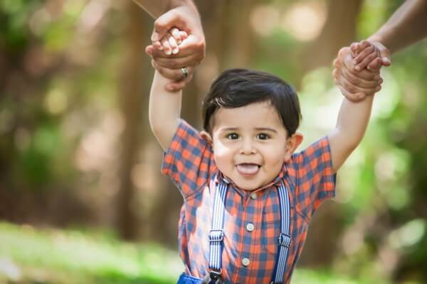 boy with suspenders and plaid shirt