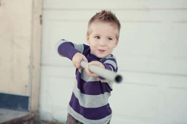 boy playing around with a pipe