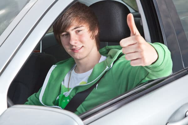 teen boy in a car