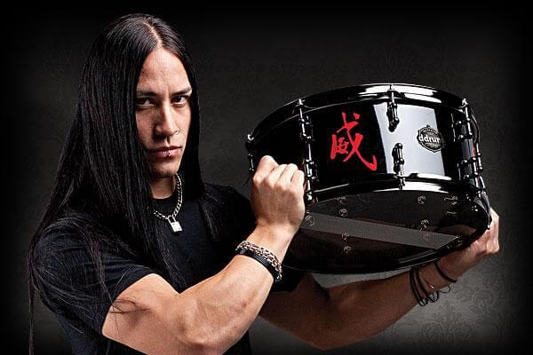 tim yeung holding a drum