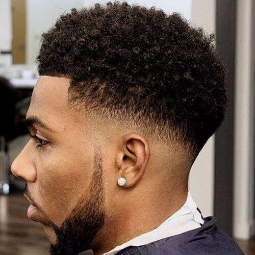 styled afro and fade hairstyle