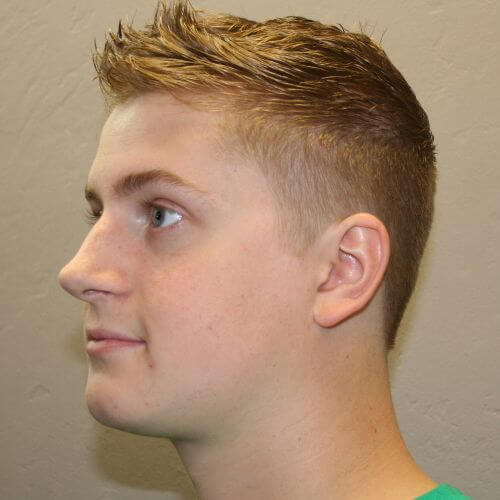 blonde guy with faux hawk