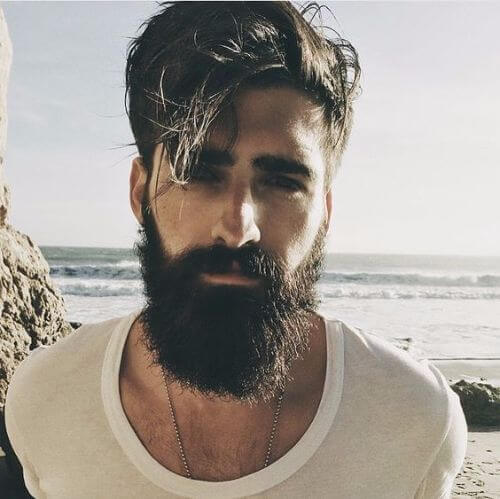 hipster haircut with messy long hair and thick beard