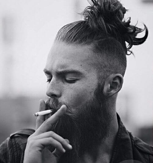 hipster haircut with very high man bun