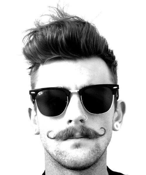 hipster haircut with llong and curled top, skin fade and moustache