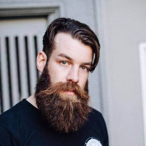 hipster haircut long front with and luxurious beard