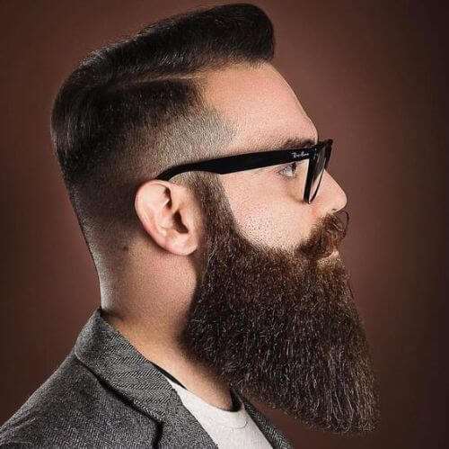hipster haircut long top, low fade, and perfectly-shaped beard