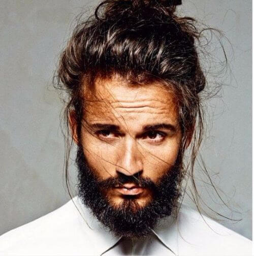 hipster haircut with messy man bun