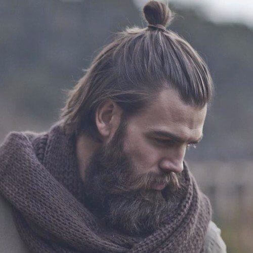 beautiful hipster haircut with samurai man bun