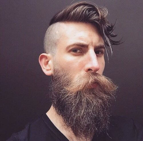 skin fade, thick beard and long and messy top hipster haircut