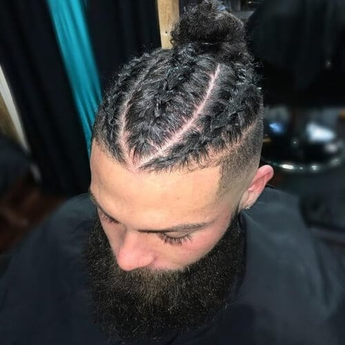 man at barber with high and tight and braids