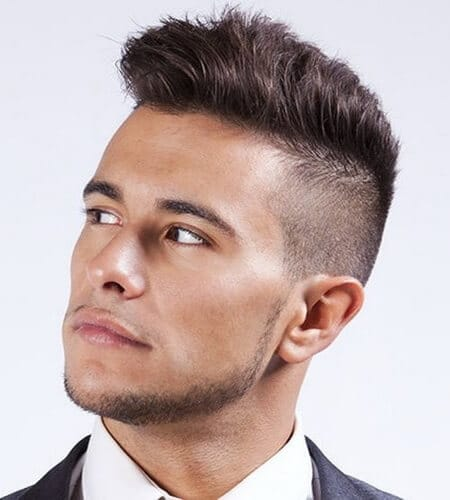 boy with high and tight quiff looking up