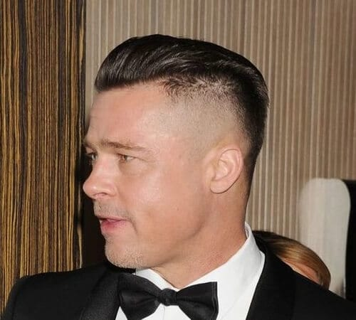 brad pitt wearing a suit and a bowtie, with a high and tight sleek haircut