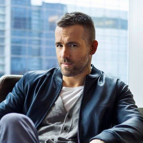 ryan reynolds sitting with a high and tight Receding Hairline cut