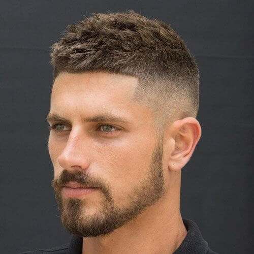 man with comb forward high and tight