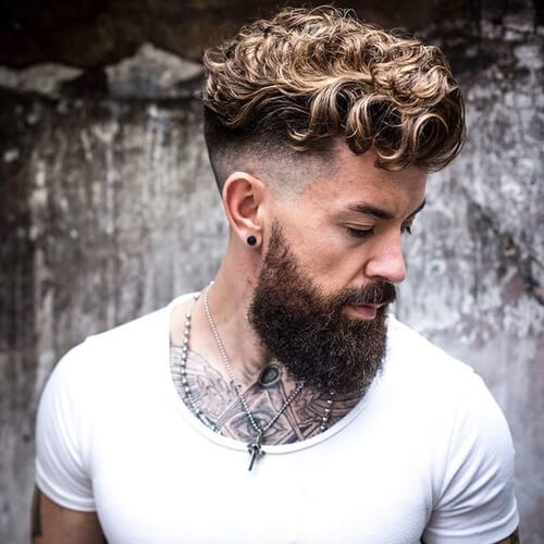 man with beard and curls