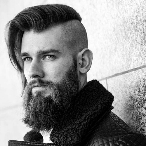 man with beard and a high and tight haircut