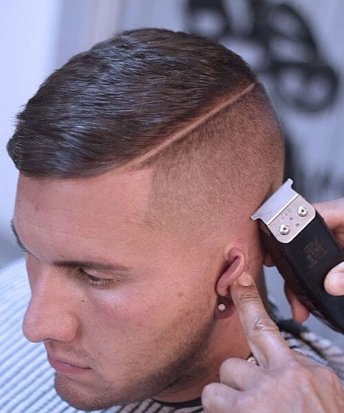 man having a high an tight haircut