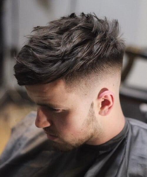 boy at barber having a The BedHead High and Tight haircut