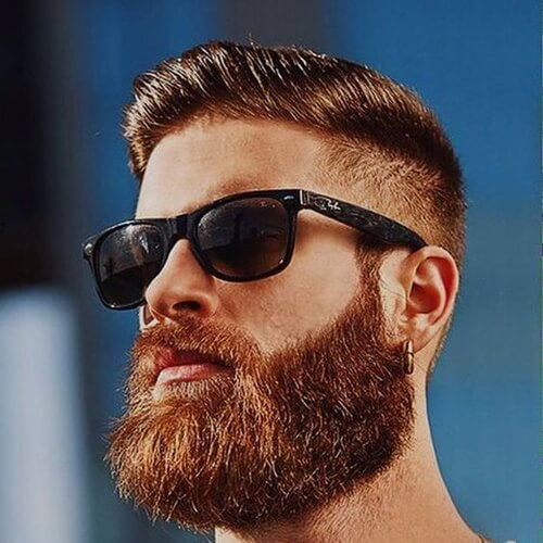 man with beard and sun glasses and high and tight
