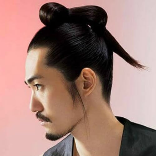 Asian man with long hair