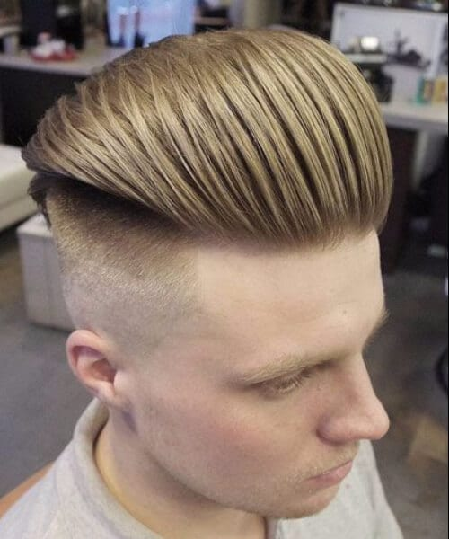 very high pompadour with slick back haircut