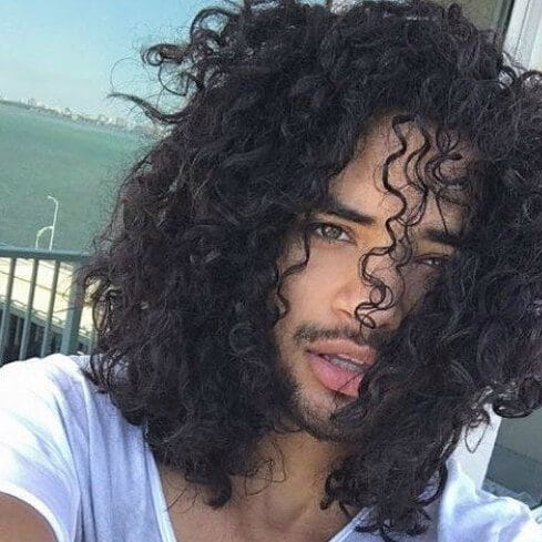 medium curly black men hairstyles