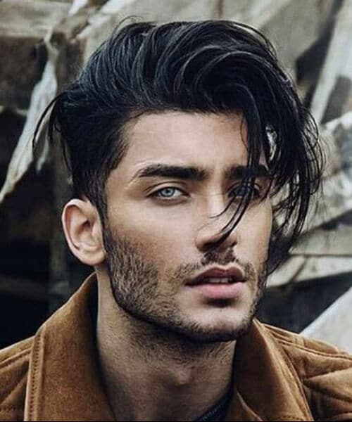 Messy Long Hair with Taper Fade and Bangs medium hairstyles for men