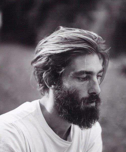 Slicked Back and beard medium hairstyles for men