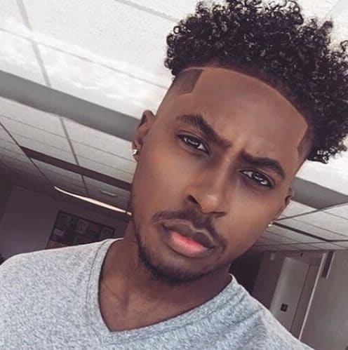 curly hightop with hard part all around black men hairstyles