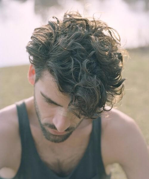 asymmetrical short curly hairstyles for men