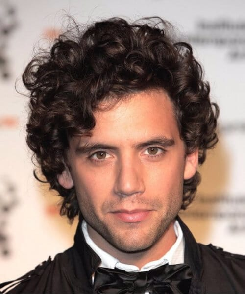 mika short curly hairstyles for men