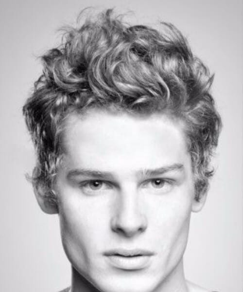 sauvage hairstyles for men with wavy hair