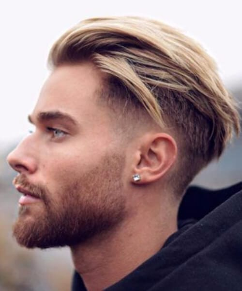 blonde textured slick back low fade haircut