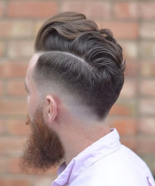 piecey layered comb over low fade haircut