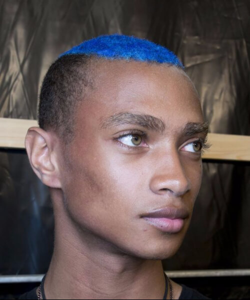 blue buzzcut undercut with curly hair