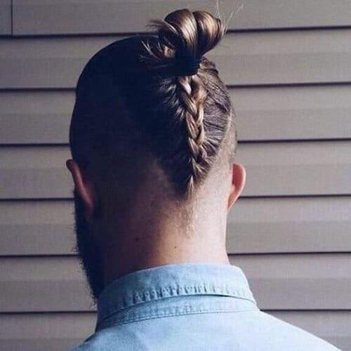 back man braids and bun bald fade with beard