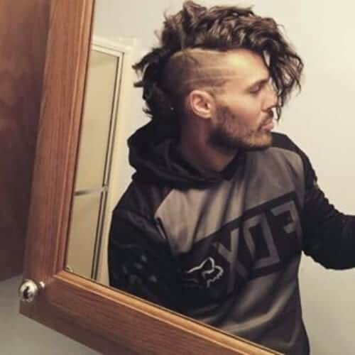 long and curly bald fade with beard