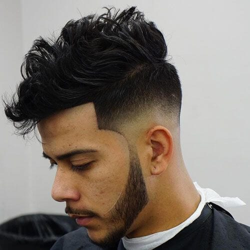 messy low bald fade with beard